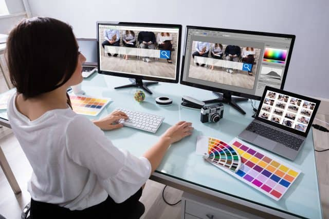 Female graphic designer editing photos on her computer