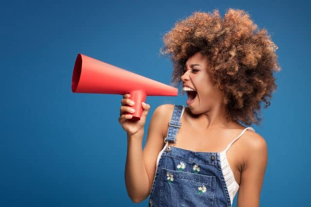 image of a beautiful black woman with a red megaphone