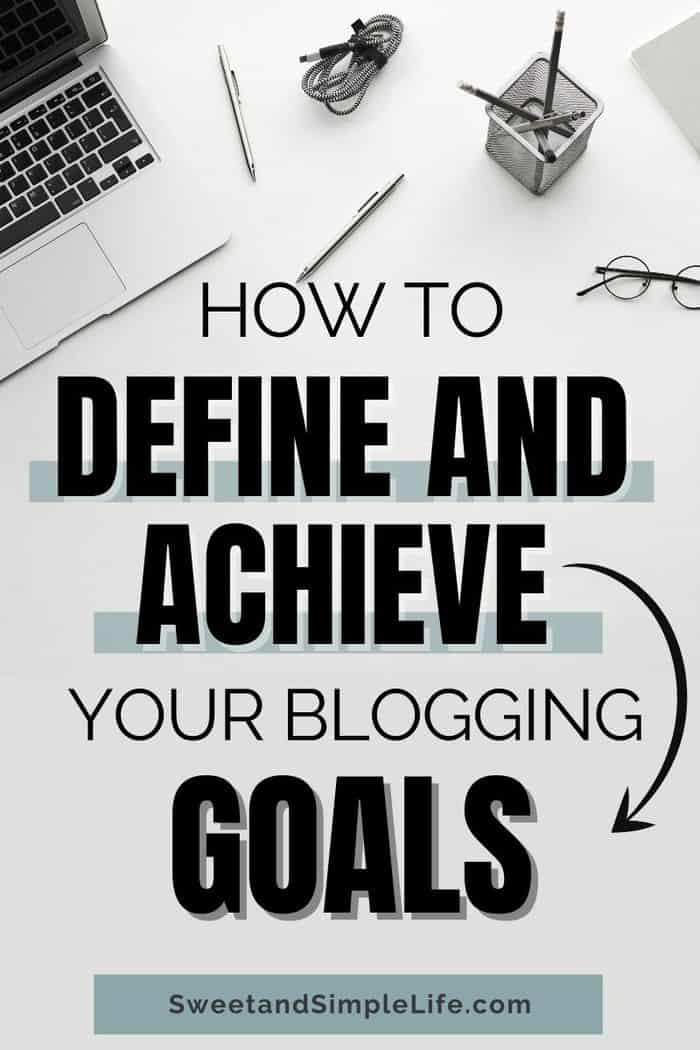 top down view of white desk, laptop, pencils with text overlay that says 'how to define your blogging goals'