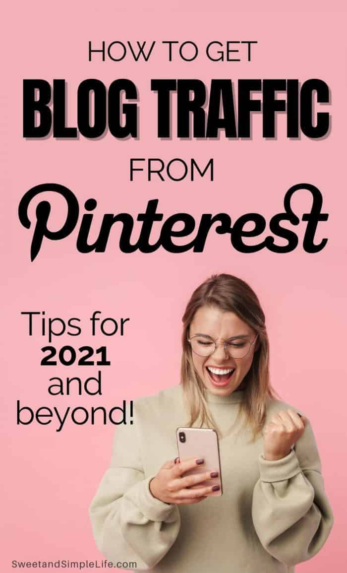 Excited woman scrolling on phone and smiling in front of pink background with text overlay that says 'how to get blog traffic from pinterest'
